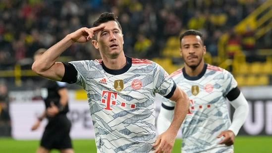 Bayern's Robert Lewandowski celebrates after scoring his side's third goal during the German Supercup soccer match between Borussia Dortmund and Bayern Munich in Dortmund, Germany, Tuesday, Aug. 17, 2021. (AP Photo/Martin Meissner)(AP)