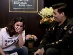 Karan Johar tells Alia Bhatt his 'sad' story.