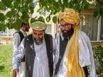 A Taliban delegation led by the head of the negotiating team Anas Haqqani (R) meeting with former Afghan government officials in Afghanistan.(AFP)