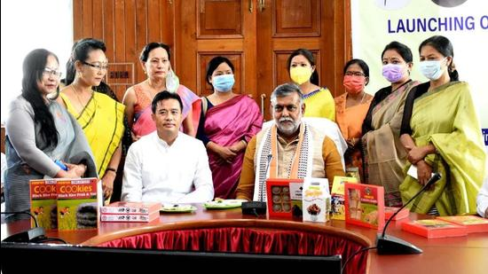 Union Minister of State for Food Processing Industries and Jal Shakti Prahlad Singh Patel with women entrepreneurs during the launch of indigenous food products in Imphal on Saturday. (HT PHOTO.)