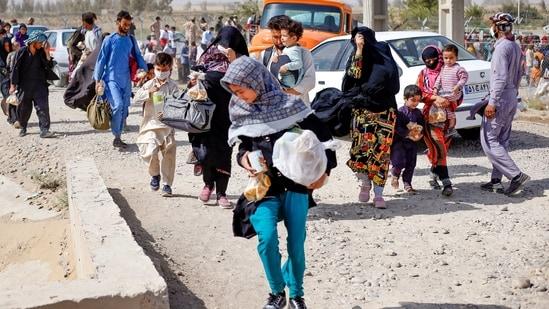 Afghan refugees at the Iran-Afghanistan border.(AFP)