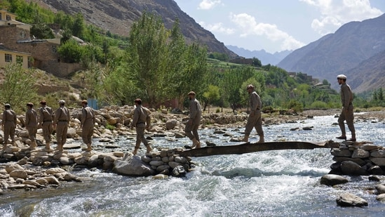 Newly absorbed personnel in the Afghan security forces take part in military training in the Bandejoy area of Dara district in Panjshir province on August 21.(AFP)
