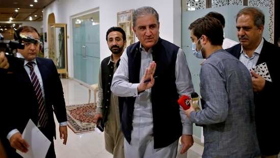 Pakistan's foreign minister Shah Mahmood Qureshi waves after leaving a press conference on Afghanistan, in Islamabad, Pakistan on Monday, Qureshi on Monday urged the Taliban and other Afghan leaders to try to reach an understanding for an inclusive political settlement as soon as possible so that an uncertain situation prevailing in Afghanistan ends. (AP)