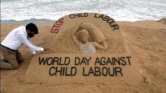 Puri: Artist Sudarsan Patnaik gives finishing touches to a sand sculpture with a message, Stop Child Labour, ahead of World Day against Child Labour, in Puri, Thursday, June 11, 2020. (PTI Photo)(PTI11-06-2020_000162A) (PTI)