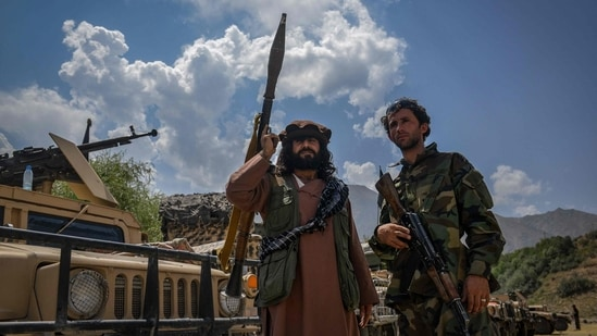 Afghan armed men supporting the Afghan security forces against the Taliban stand with their weapons and Humvee vehicles in Panjshir province.(AFP Photo)
