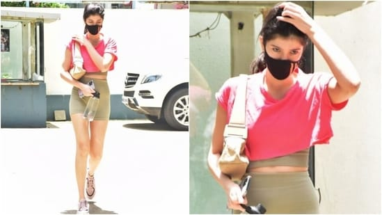 Shanaya teamed the top with a matching pair of beige biker shorts with a high-rise waistline. She wore the ensemble with chunky sneakers and a black face mask.(HT Photo/Varinder Chawla)