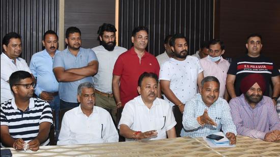 Members of Ludhiana Hotmix Plant Welfare Association addressing the media in Ludhiana on Tuesday. (Gurpreet Singh/HT)