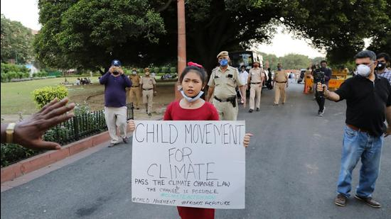 Licypriya Kangujam, 8, India's young climate activist, carrying a placard attends a protest demanding the passing of a climate change law outside the parliament in New Delhi, India, September 23, 2020. (REUTERS)