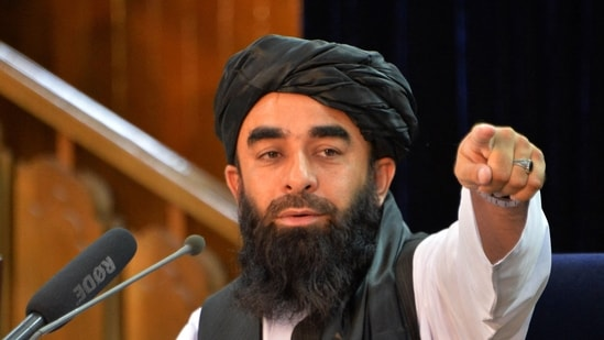 Taliban spokesperson Zabihullah Mujahid gestures during a press conference in Kabul on August 24, 2021.(AFP)