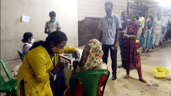 A beneficiary receives a dose of Covid-19 vaccine during a vaccination drive at a cinema hall in Kolkata on Tuesday, August 24. (ANI)