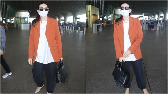 Karisma teamed the jacket with an oversized white printed T-shirt. The way she layered the baggy fits together turned her simple outfit glam. We are taking notes.(HT Photo/Varinder Chawla)