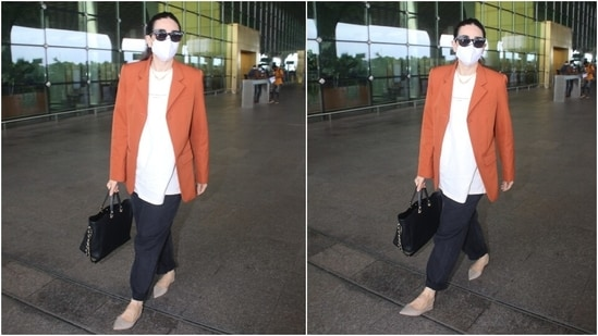 Karisma completed her ensemble by wearing high-waisted black-coloured mom denims. She folded the hems of the pants to give it a trendy touch. She looked effortlessly chic in the outfit.(HT Photo/Varinder Chawla)