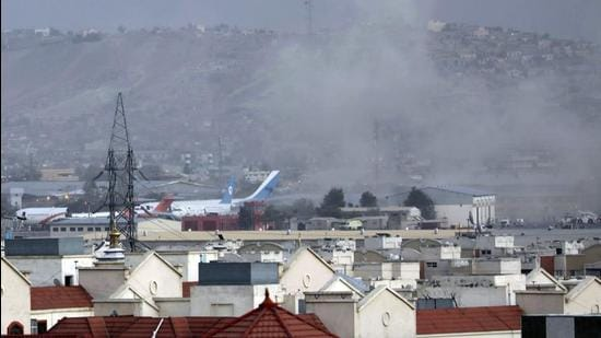 Smoke rises from a deadly explosion outside the airport in Kabul, Afghanistan on Thursday. (AP PHOTO)
