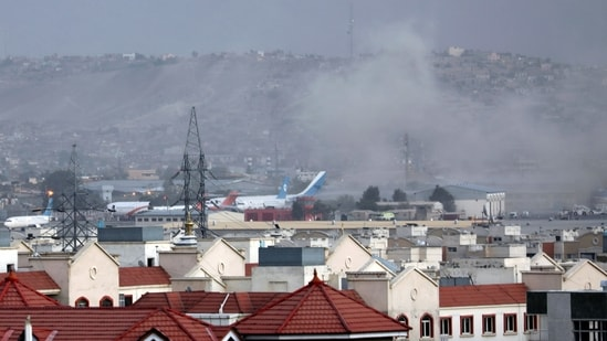 Smoke rises from explosion outside the airport in Kabul, Afghanistan, Thursday, Aug. 26, 2021.(AP)