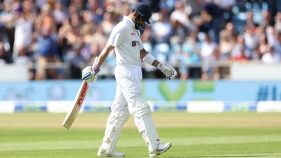 Virat Kohli walks off after being caught out by England's Joe Root(Action Images via Reuters)