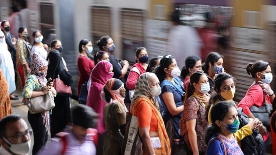 Commuters wearing protective face masks wait to board a suburban train after authorities resumed train services for vaccinated passengers amid the coronavirus disease (Covid-19) pandemic, in Mumbai. (File Photo / REUTERS)