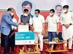 Union health minister Mansukh Mandaviya releases the first commercial batch of Covaxin, at Ankaleshwar on Sunday. ANI
