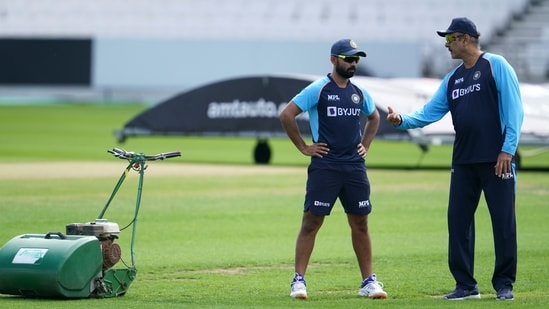 Indian cricket coach Ravi Shastri, right, with Ajinkya Rahane during a nets session at Headingley cricket ground in Leeds.(AP)