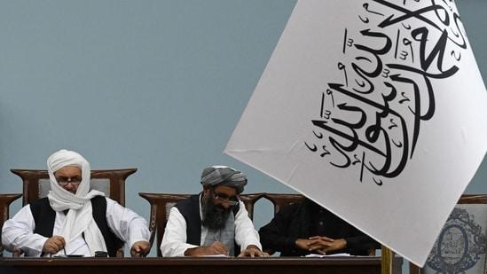 Taliban's acting Higher Education Minister Abdul Baqi Haqqani (L) attends a consultative meeting on Taliban's general higher education policies at the Loya Jirga Hall in Kabul. (AFP)