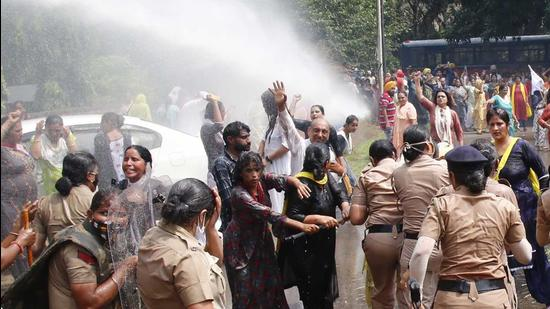 A few AAP leaders and workers sustained injuries after police resorted to the use of water cannons to disperse them.