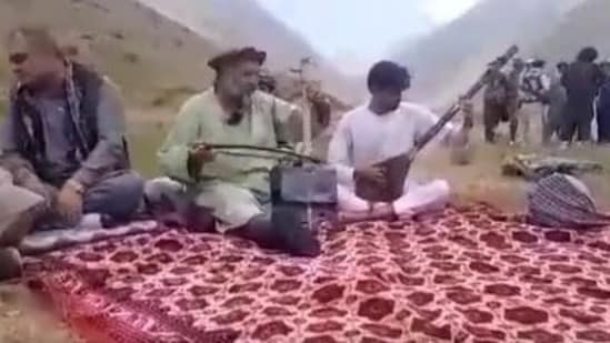 After the news of the killing of Fawad Andarabi surfaced, videos of the singer (middle) were shared on social media. (Photo: Twitter)