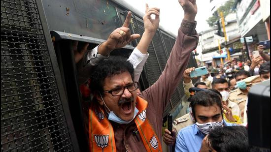 Police detain BJP workers after they protest against Maharashtra government demanding reopening of temples as part of their statewide agitation amid Covid curbs, at Kandivli in Mumbai on Monday. (HT PHOTO)