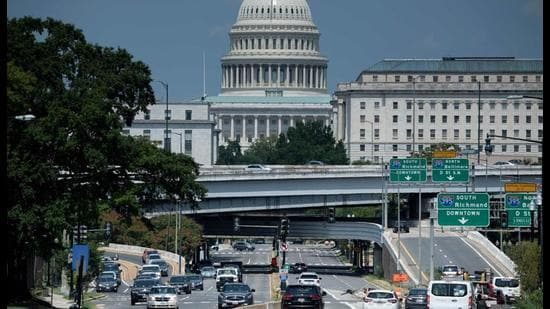 People drive near Capitol Hill in Washington, DC. (AFP)
