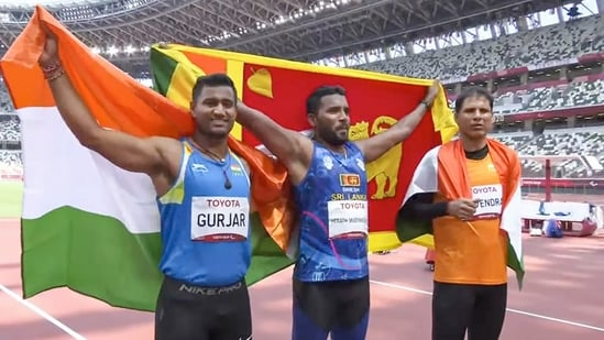 Indian athletes silver medalist Devendra Jhajharia (R) and bronze medalist Sundar Singh Gurjar (L) with gold medalist Sri Lanka's Dinesh Priyantha(PTI)