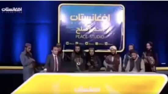 The Taliban fighters were standing behind the presenter of Afghan TV's Peace Studio political debate programme. (Kian Sharifi/Twitter)
