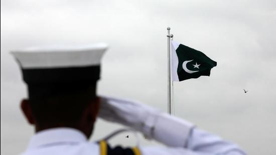 A navy cadet salutes during a flag hoisting ceremony to celebrate Pakistan Independence Day, at the mausoleum of founder, Mohammad Ali Jinnah, in Karachi, on August 14. (REUTERS)