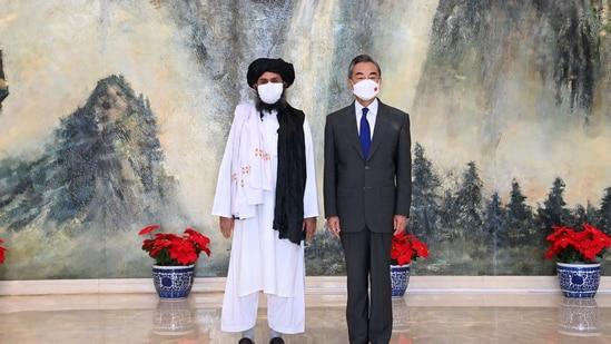 Taliban leader Mullah Abdul Gani Baradar with Chinese foreign minister Wang Yi.