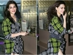 On Tuesday, August 31, Kriti Sanon was snapped by the paparazzi outside the airport. For her flight out of Mumbai, the actor aced the jet-set look in a check ensemble. She flaunted her long legs in the trendy look, and we are sold.(HT Photo/Varinder Chawla)