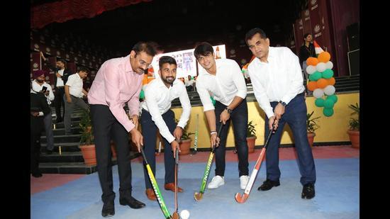 Olympic gold medallist Neeraj Chopra with Niti Aayog CEO Amitabh Kant and others at Phagwara on Tuesday.