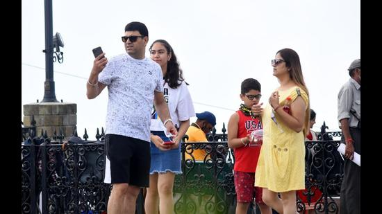 Tourists spotted without face masks on The Ridge in Shimla. Flouting of Covid norms is the major reason why cases in Himachal are consistently going up. (Deepak Sansta/HT)