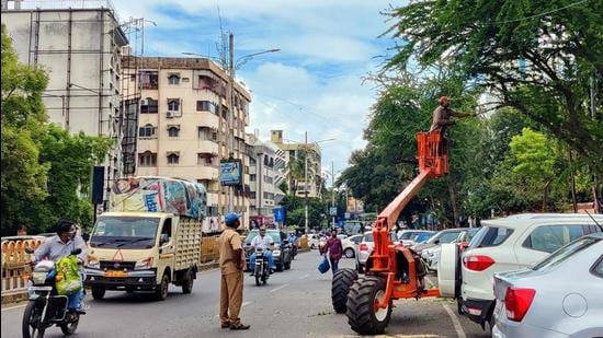 Trees cut during peak hours on East Street in Camp in Pune, on Wednesday. (Rahul Raut/HT PHOTO)