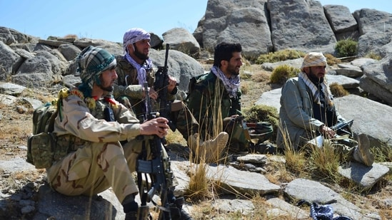 Afghan resistance movement and anti-Taliban uprising forces take rest as they patrol on a hilltop in Darband area in Anaba district, Panjshir province. (AFP)