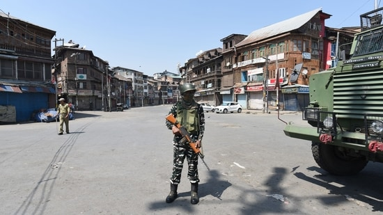 A soldier stands guard in Srinagar on Thursday. (Photo By Waseem Andrabi/Hindustan Times)