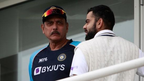 India's captain Virat Kohli and Ravi Shastri.(AP)