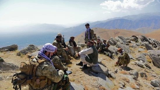 Afghan resistance movement and anti-Taliban uprising forces take rest as they patrol on a hilltop in Darband area in Anaba district, (AFP)
