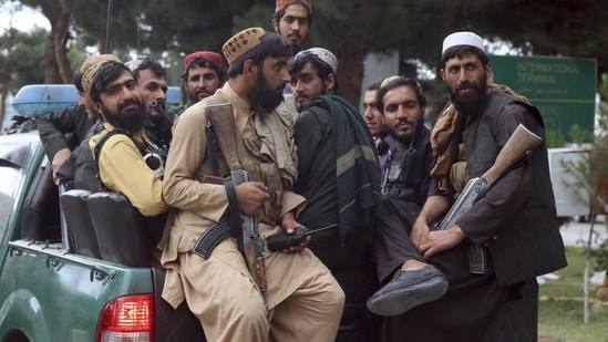Taliban fighters at the Hamid Karzai International Airport after the US military's withdrawal, in Kabul on August 31.