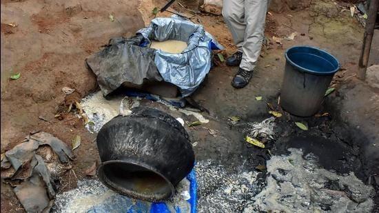 An illicit liquor unit being destroyed. (HT FILE PHOTO)