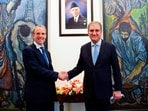 Pakistan's Foreign Minister Shah Mahmood Qureshi (R) welcomes Britain's Foreign Secretary Dominic Raab upon his arrival at the Ministry of Foreign Affairs (MoFA) in Islamabad.(via Reuters)