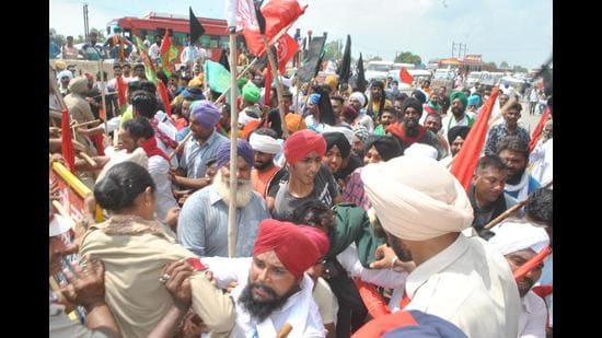 Protesters trying to break through police cordon to reach the rally venue of Shiromani Akali Dal in Moga on Thursday.