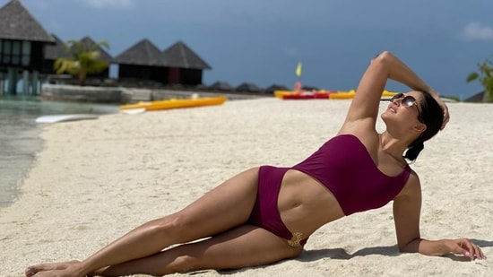 Sunny Leone recently shared a picture in a burgundy-coloured monokini that flaunted her well-toned legs and a waistline to die for. Oozing oomph like never before, the diva pulled back her sleek hair into a low bun and accessorised her look with a pair of sunglasses as she laid down on the white sand beach and bathed in the sunlight.(Instagram/sunnyleone)
