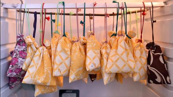 Cloth bags with the bats inside hang in a fridge prior to their awakening after winter hibernating at a bat rescue centre in Minsk on March 23, 2019. (Photo by Sergei GAPON / AFP) (AFP/REPRESENTATIVE PHOTO)