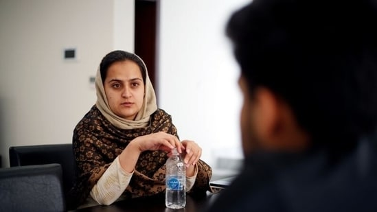 Afghan news anchor Beheshta Arghand speaks to her brother at a temporary residence compound in Doha, Qatar, on September 1, 2021. (Hamad I Mohammed / REUTERS)