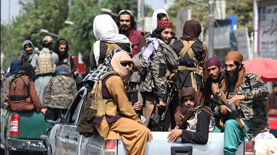 Taliban fighters patrol on vehicles along a street in Kabul on September 2. (AFP)