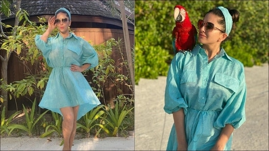 Serving another sizzling mini dress look, Sunny Leone flooded the Internet with her smoking hot pictures in a sheer blue lagoon dress and hairband from Peeké and posed with a macaw perched on her shoulder. The blue mini dress sported tiny white polka dots all over, came with a collar that extended into a buttoned down front and featured two pseudo chest pocks, balloon sleeves that were cinched at the elbow, an asymmetrical hemline and a drawstring that cinched the dress at the waist.(Instagram/sunnyleone)