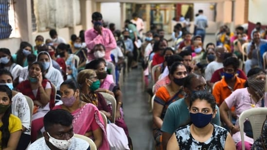 Citizens wait to get inoculated against Covid at a vaccination centre at Dadar in Mumbai.(Satish Bate/HT Photo)