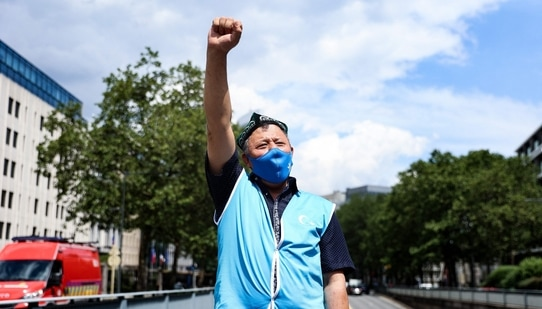 A demonstrator from the Uyghur Community gestures as he takes part in a protest(AFP)